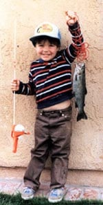 Age 5. Just caught my first fish. I thought it was huge.