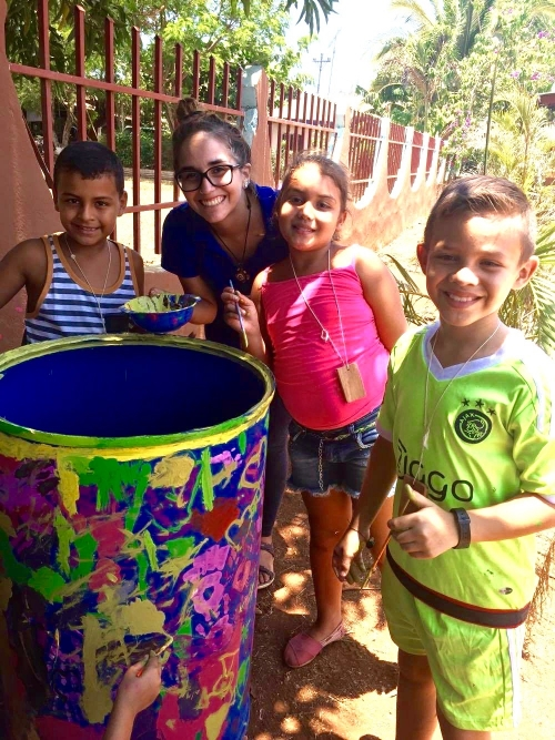 Kids decorating recycling bin. Photo cred: Lauren Hayden.
