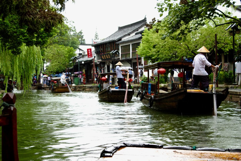 Small gondolas cruising the canals in Zhujiajiao.