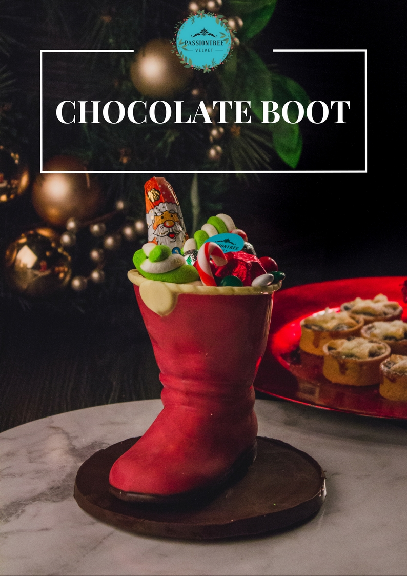 Christmas Boot (NSW Only):  Decadent chocolate boot made entirely out of chocolate including the base! Filled with lollies, chocolates and sweet treats, our Chocolate Boot will definitely be a crowd favourite.