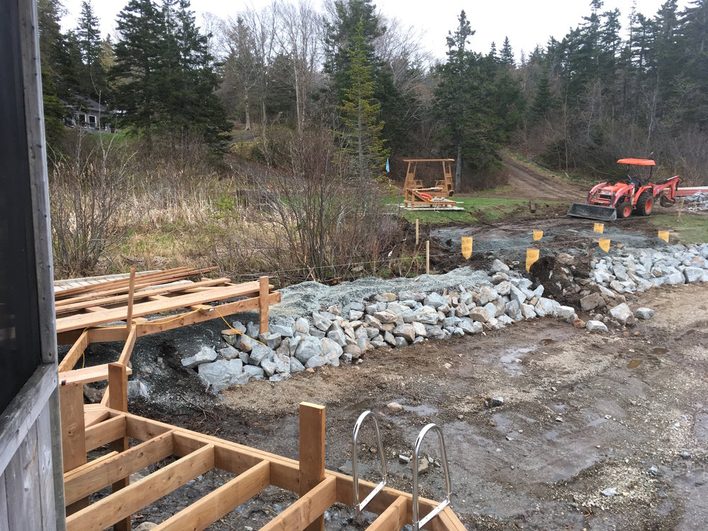 A view to the new seawall with partial boardwalk framing.