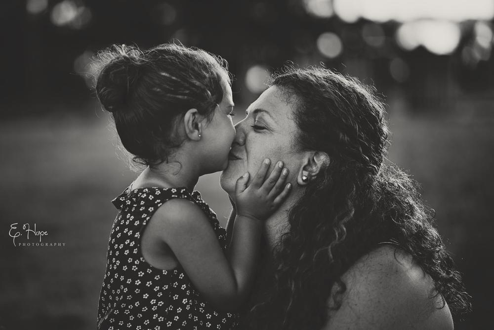 Ava giving her mom sweet kisses at the Veteran War Memorial Park in St. Petersburg, FL