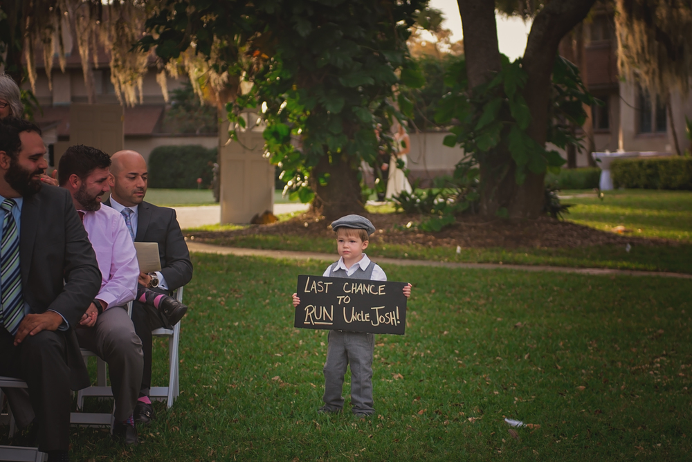 "the last to walk the isle before Dani joined her groom, was Josh's cute lil nephew, with the ""Last Chance to Run"" sign.  I thought this was cutest thing, and captured perfectly by Ryan!"