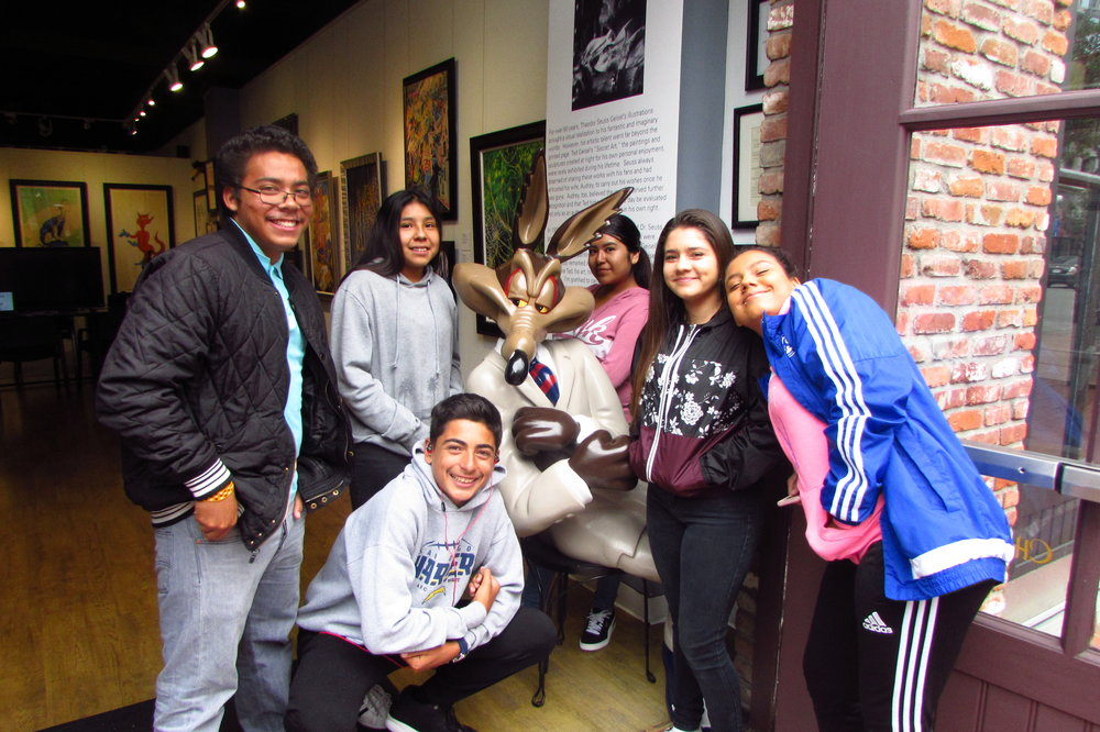 La Mesa students preview the Words Alive Arts Component exhibition, which featured their animated films and writing, at Chuck Jones Gallery on June 6.