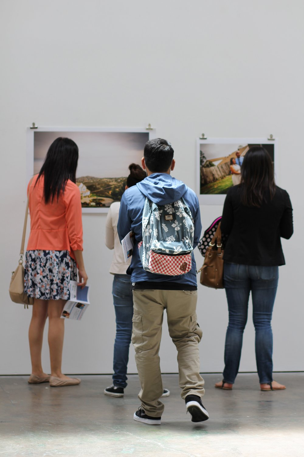 Students viewing their work in a local gallery.