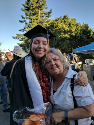 A picture of past WAWS scholar Brittany Jackson with her mentor Sarah Archibald. The picture was taken at Brittany's graduation from the University of California, Santa Cruz.