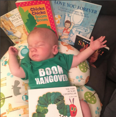 A #shelfie from last year's Share Your Love of Reading campaign! The picture features a young baby surrounded by books! You're never too young to start reading!