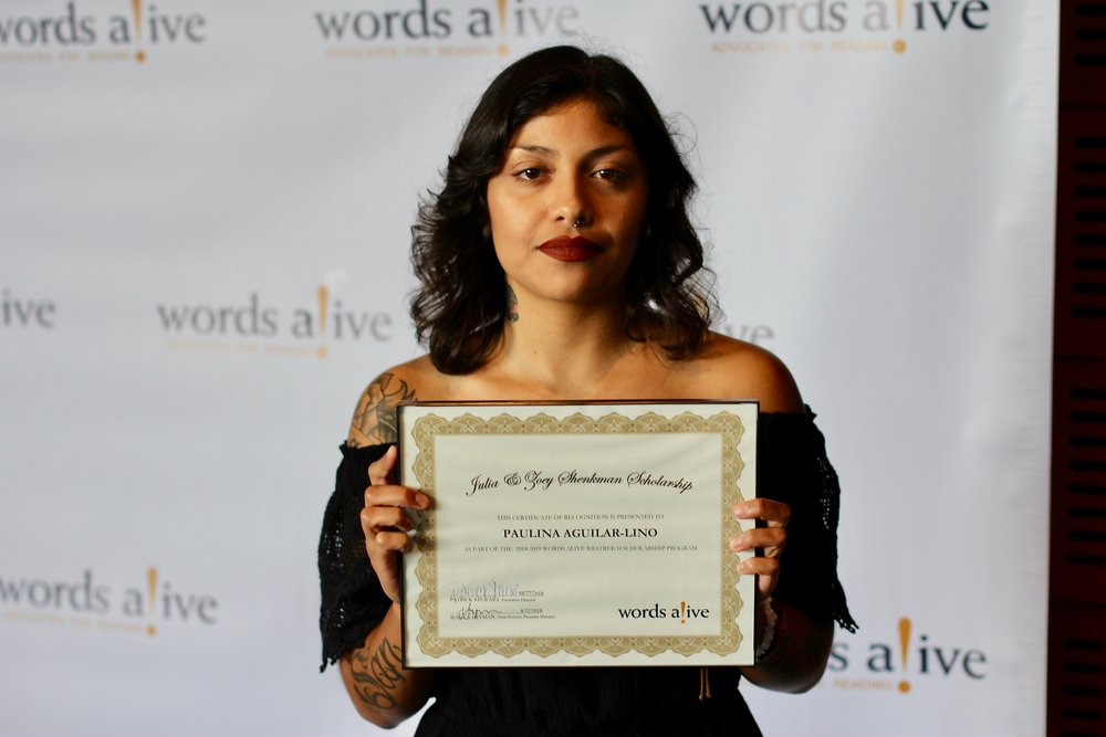 An image of Paulina Aguilar-Lino holding her award in front of a Words Alive backdrop.