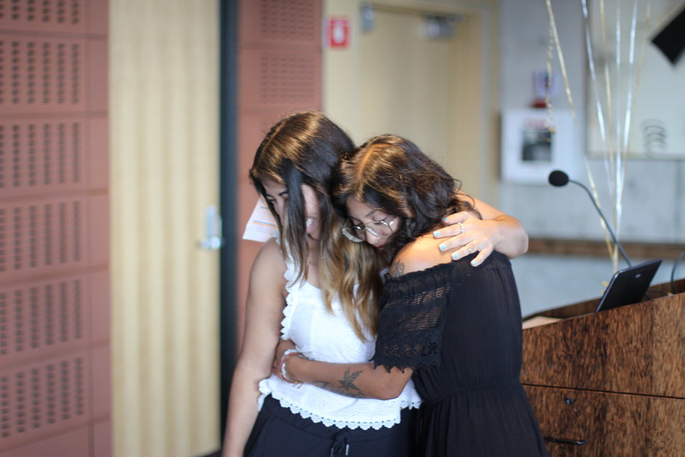 An image of Paulina hugging, Annette Ruiz, who presented her award at the Words Alive Westreich Scholarship ceremony.