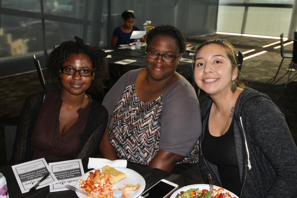 An image of Brittany with her new mentee, Antonise (far left), with another scholarship recipient Domminiece (middle).