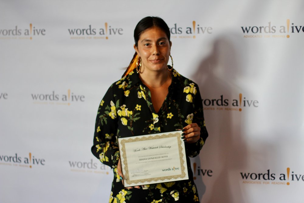 An image of Diana holding her award at the Words Alive Westreich Scholarship Ceremony.