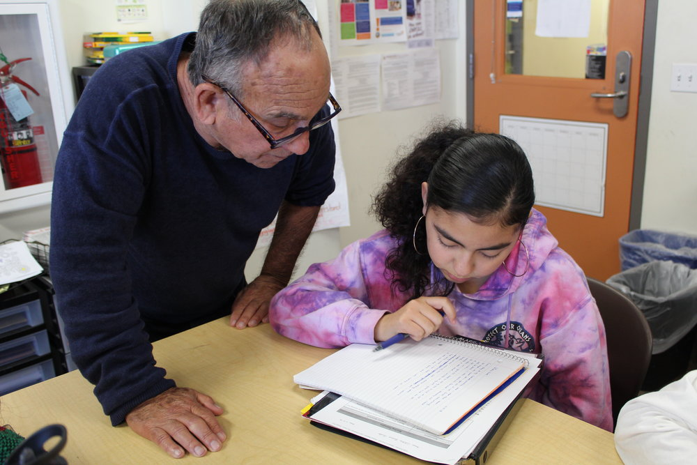 Rick Seidenwurm working with an Adolescent Book Group student at the Monarch School.