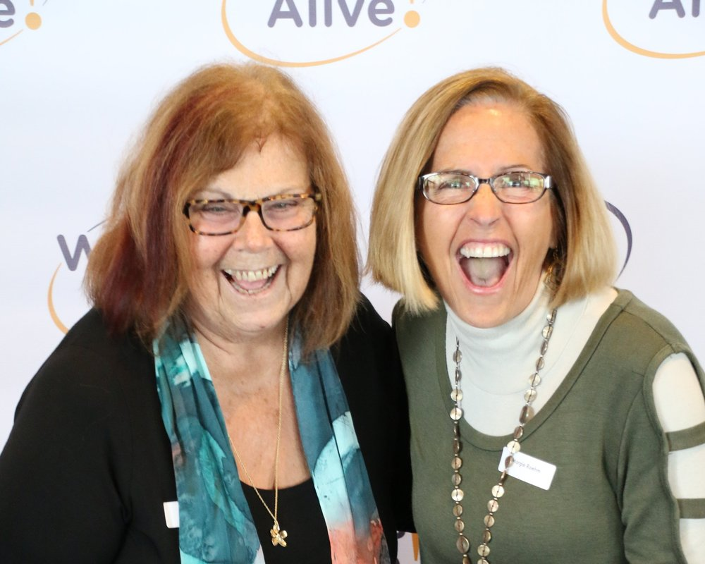 An image of two of our incredible volunteers, Karen Mailn & Margie Roehm laughing at the camera.