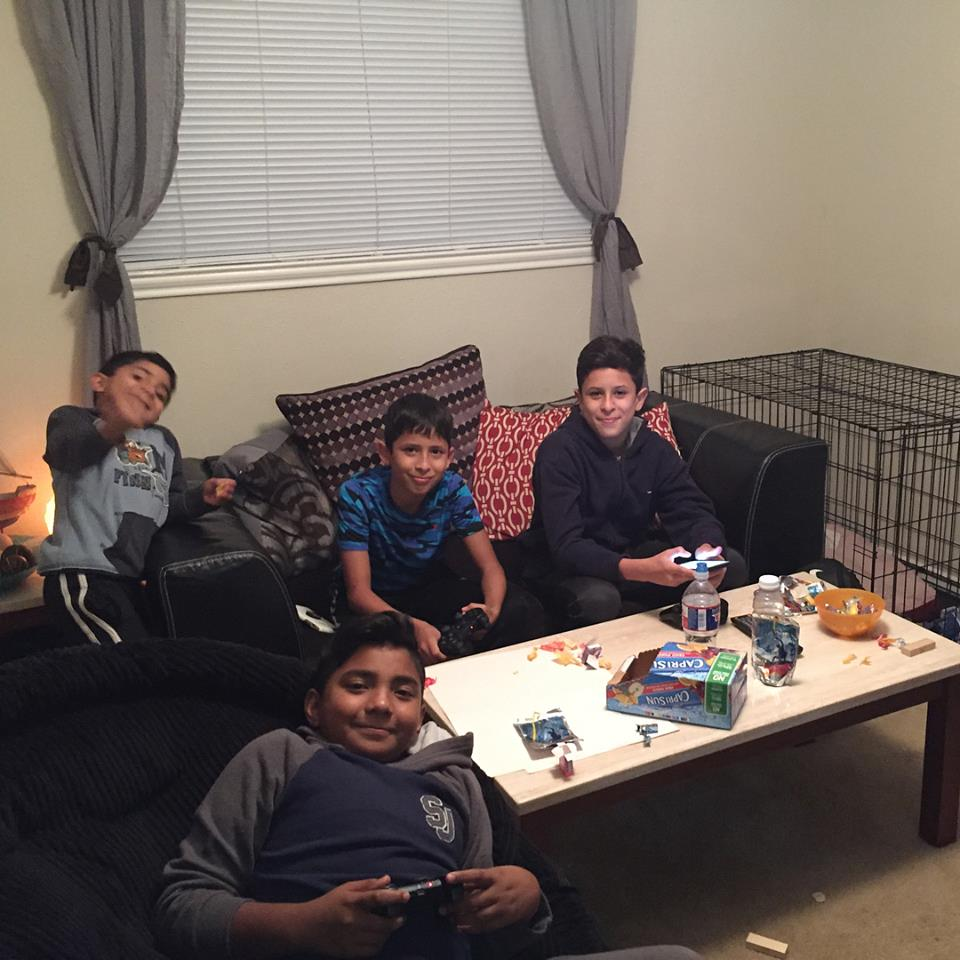 My friends Alex & Christine Nuñez welcome neighborhood boys into their home