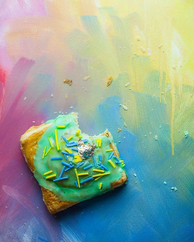 "I went in a different direction with this inspiration shoot. . . . I love bright, cheerful light and rich colors, but that's not what @crumbbar is about. . . . While snapping and struggling, my co-serendipitous soul, @patti_artgirl, encouraged me to think about Crumb Bar's brand, not mine. . . . ""They're bold, modern, in your face, and they don't care whether you like it or not. Look at the colors she (@sister.psyar ) chooses. Think of how you can infuse their aesthetic into your photos,"" she encouraged. . . . Patti then proceeded to pull out this kaleidoscope back painting she had started years ago. That's it, that was my backdrop! And from there, these photos emerged. . . . Thank you, Patti, for always encouraging me to find a different perspective and for your wise words."
