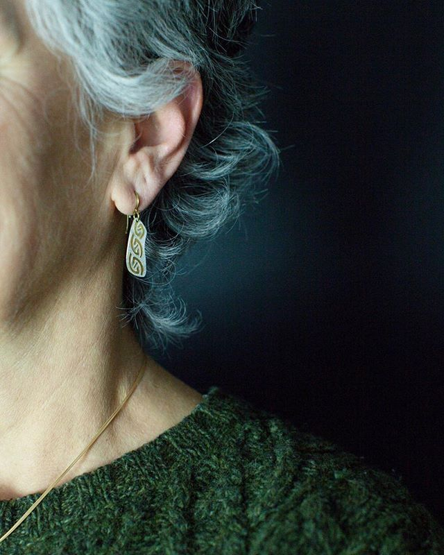 I love the shape and pattern of these Celtic earrings! . . . Earrings by Deirdre Donnelly Jewelry. Find them at the @leagueofnhcraftsmen_littleton. . . . Modeled by @patti_artgirl of @serendipitystudios18. . . . #megabugmakers #megabugproduct #leagueofnhcraftsmen #leagueofnhcraftsmen_littleton #buylocal #shopsmall #productphotography #productphotographer #jewelry #jewelrydesigner
