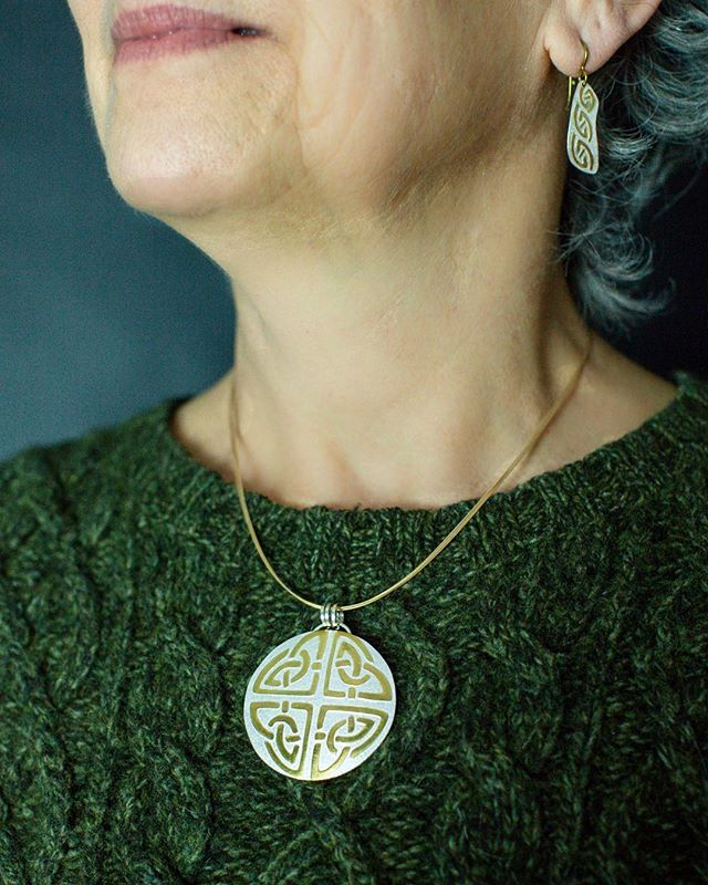 Happy St. Patrick's Day! Are you wearing green? How about a traditional Celtic medallion necklace? . . . This beauty by Deirdre Donnelly Jewelry is available at the @leagueofnhcraftsmen_littleton. . . . Modeled by @patti_artgirl of @serendipitystudios18. . . . #megabugmakers #megabugproduct #leagueofnhcraftsmen #leagueofnhcraftsmen_littleton #buylocal #shopsmall #productphotography #productphotographer #jewelry #jewelrydesigner