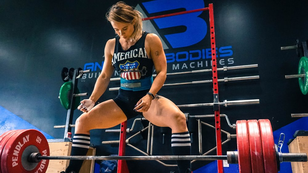 This image of a female bodybuilder preparing to lift a barbell with multiple plates is a great talking piece for capacity. While this body builder can improve her capacity with training, there are certain fundamental traits that allow her to lift the weight in the first place.  Photo courtsey of  Alora Griffiths on  Unsplash