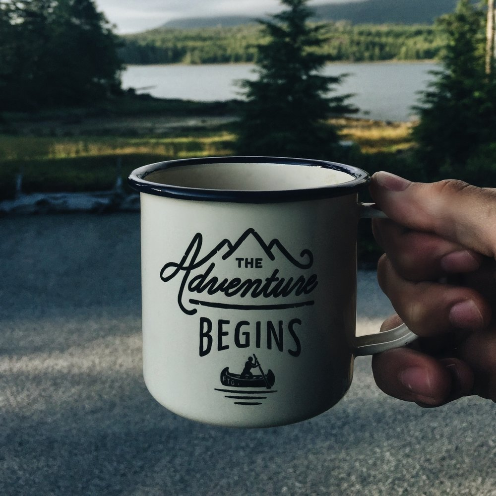 "When building any kind of a custom system, I'm reminded of waking-up early before a long trip and enjoying a cup of coffee. Just as the caption on this coffee cup set against the backdrop of trees and a lake suggests, ""The adventure begins,"" when you commission a custom LMS so make sure to fuel-up on caffeine!   Photo courtesy of  Matthew Sleeper  on  Unsplash"