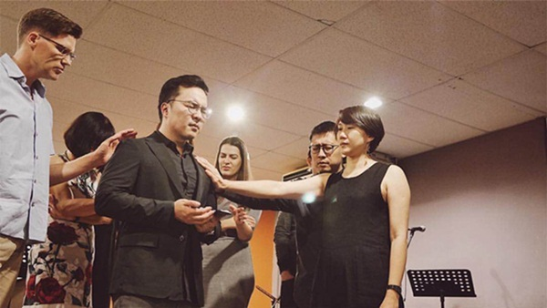 The current PenHOP leaders praying over Josh Yeoh during the 8th Year Anniversary.