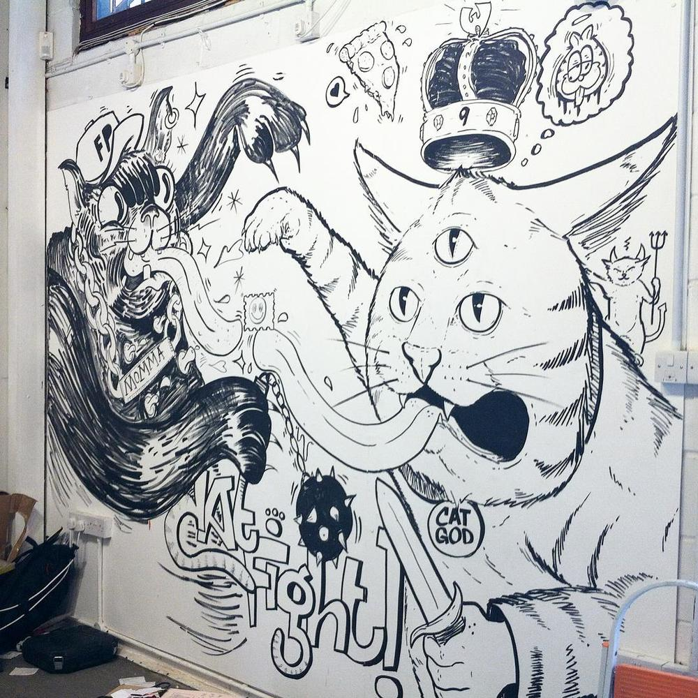 Cat Fight: Meow It's Purrsonal! @mrmillerchip @njgmart and myself getting bizzaaaaaay on this wall at @thelondonillustrationfair #penpushers vs #brothersofthestripe (at The London Illustration Fair)