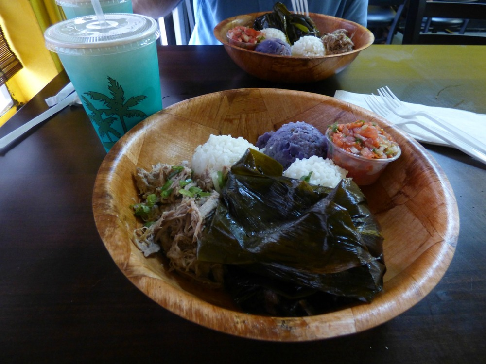 Hawai'ian plate: Lau-lau, Kahlua Pork, Lomi-lomi salmon, Sweet Potato Salad and Rice. Lau-lau is a traditional pork dish wrapped into taro leaves.