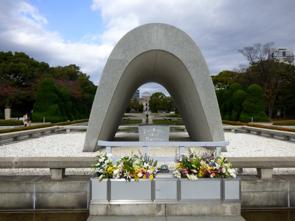 You can see the A-Bomb Dome through the  Hiroshima Memorial Cenotaph . Names of the victims are written on it.