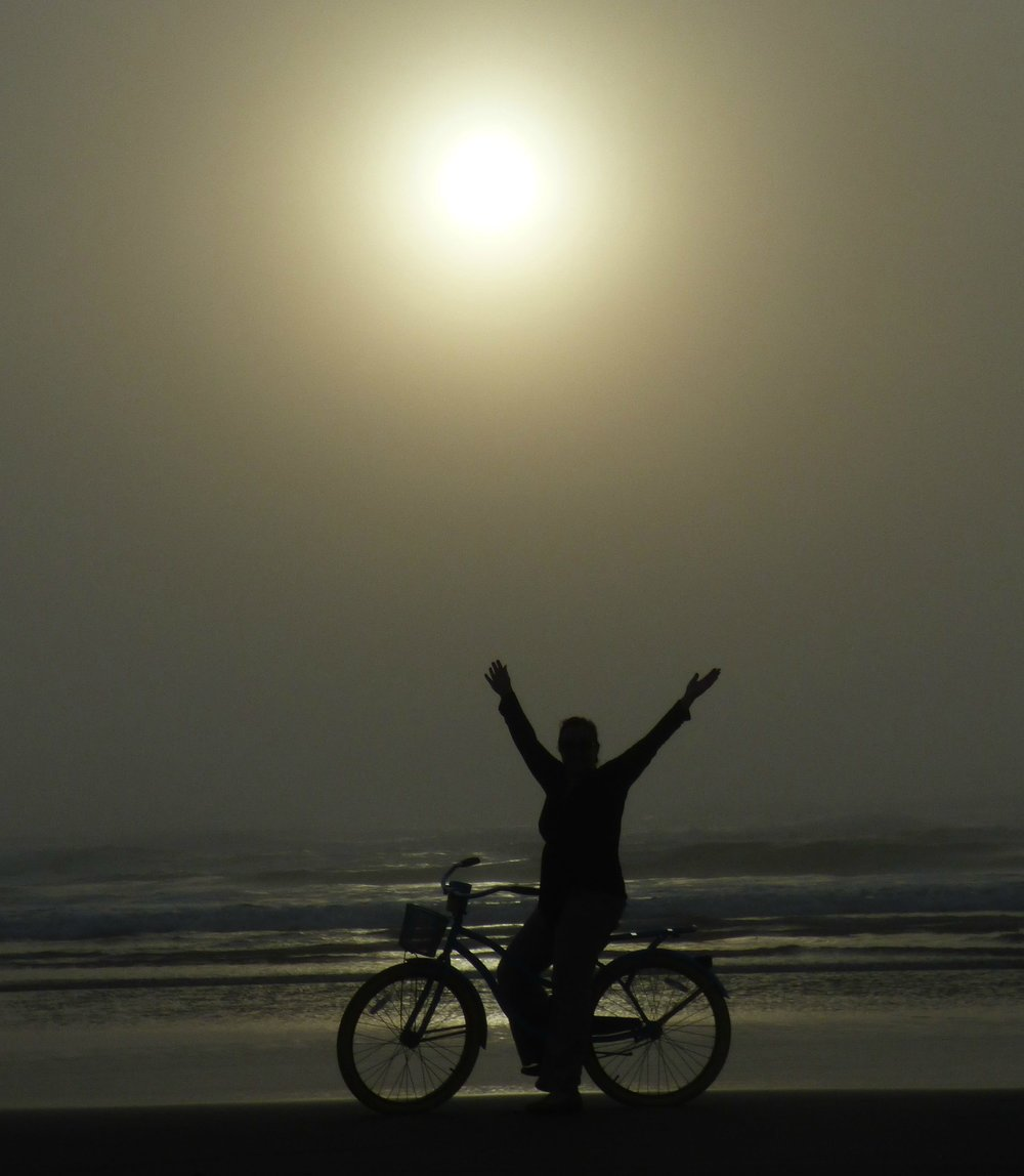 Riding a bicycle at the beach was fun, but it was so cold that we needed many layers of clothes.