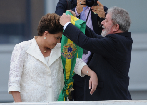 Rousseff receives the presidential sash in 2011.