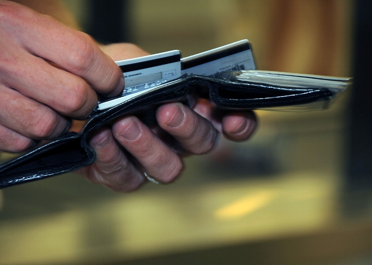 1280px-US_Navy_080918-N-0659H-001_A_Naval_Support_Activity_Mid-South_Sailor_takes_a_moment_to_decide_which_credit_card_to_use.jpg