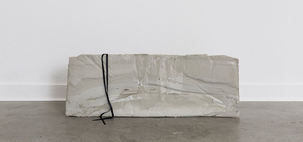 """2017,  I knew who I was this morning, but I've changed a few times since then. , Concrete and ribbon, 15"""" x 41.5"""" x 1"""""""
