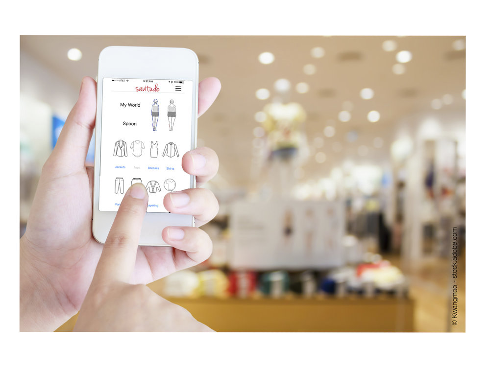 hand hold mobile phone with clothing store background