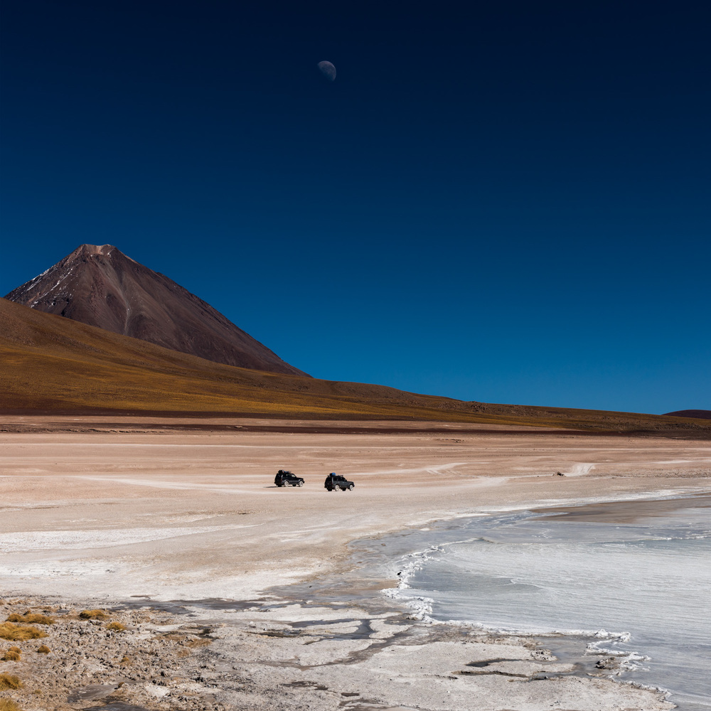 Laguna Blanca, with our 4WD tour vehicles in the background and Licancabur in the distance.