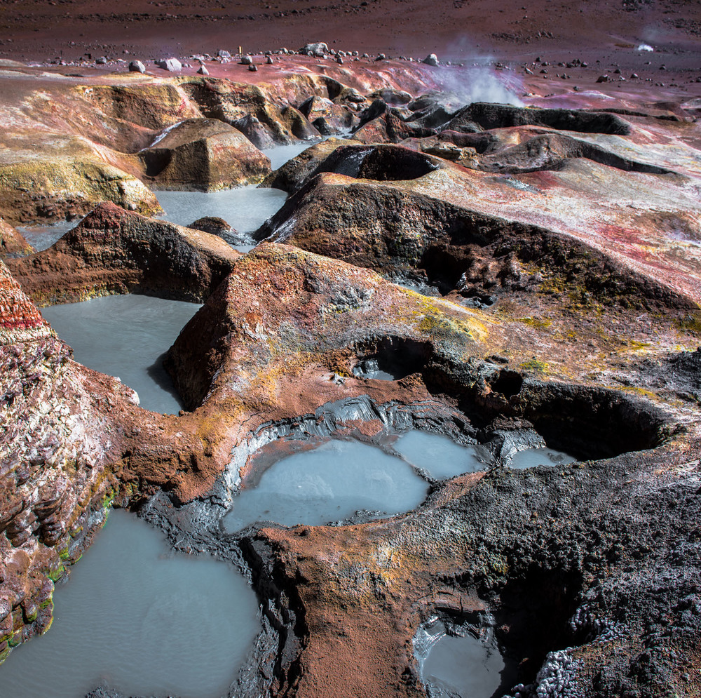 The boiling mud pools of the Sol de Manana geyser field