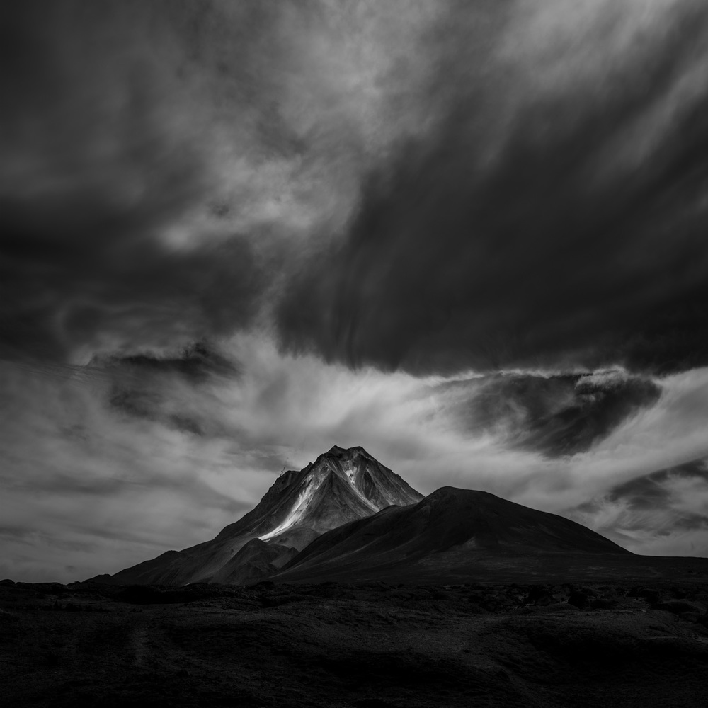 Volcan Ollague under moody skies.