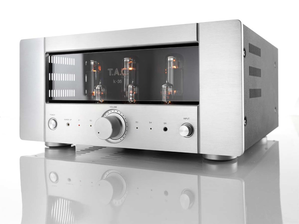 T.A.C K35 Tube Integrated Amplifier Reg: $3999      Special: $2499 The latest developed devices of T.A.C. changed in their appearance which also shows the big steps of evolution. Similar to the actual highest level of T.A.C., the V-60, K-35 works with an automatic bias control unit. With this unit, the tubes work at the optimal operating point at any time. So there will be no more influences due to warming or aging of the tubes, even new tubes can be installed without any manual adjustment setting. This assures an optimized cooperation of preamplifier tubes (12AX7x1, 12AU7x2) and power tubes (EL34x4). The K-35 uses an Alps po tentiometer for volume setting, which can also be done by remote-control.