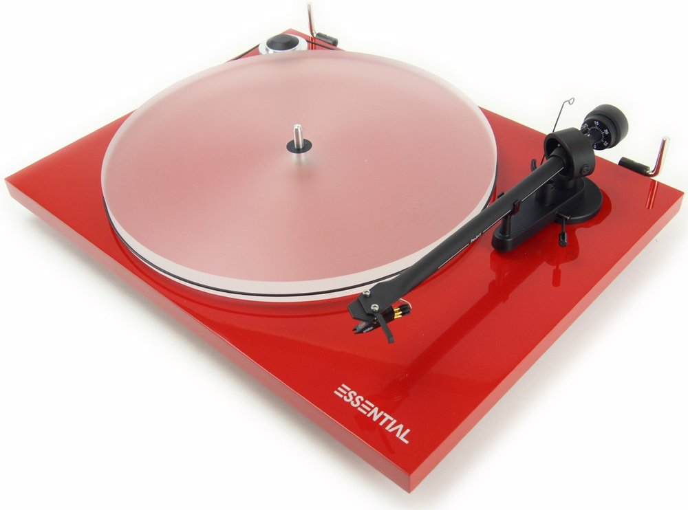 Pro-Ject Essential III    $445 Essential III offers a variety of enhancements compared to its successful predecessor, such as a diamond-cut aluminum drive pulley, a resonance-optimized MDF main platter and MDF chassis. The refined, high-precision platter bearing has significantly lower tolerances than Essential II. Essential III is the audiophile entry turntable! The setup is very simple, the included Phono RCA cable, Connect it E, sounds far above its price range. Equipped with the high-quality pickup OM10 by the phonographic cartridge pioneer Ortofon, Essential III delivers lively, balanced and highly involving sound that will delight every vinyl lover.   Essential III comes in the aesthetic highgloss colors black, red and white.