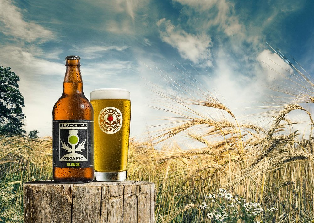 Blonde by Black Isle Brewery -  Studio shot of beer bottle and glass combined with landscape image of barley, post, sky and countryside.