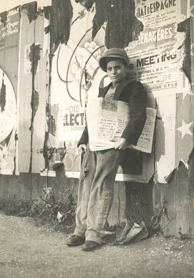 A paperboy distributing news in the 1920s
