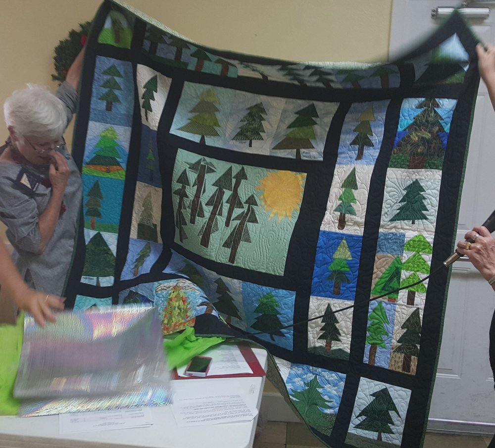 President Barbara Tate's quilt presentation