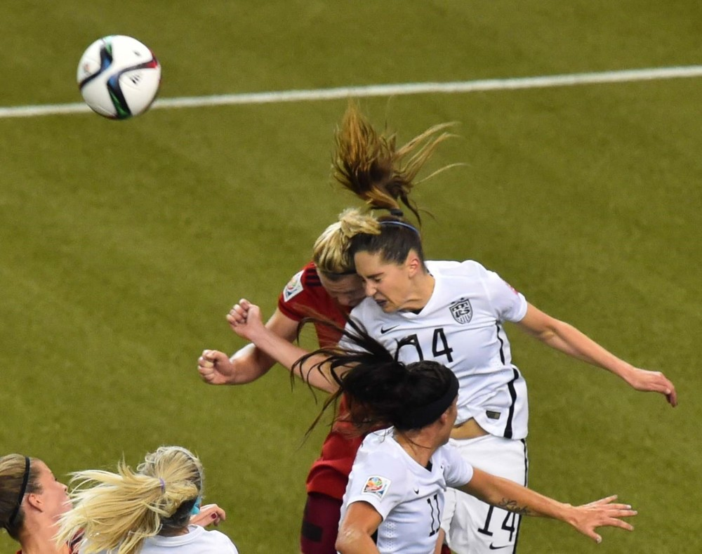 Morgan Brian collides in last summer's FIFA Women's World Cup with German forward Alexander Popp Photo credit NICHOLAS KAMM/AFP/Getty Images
