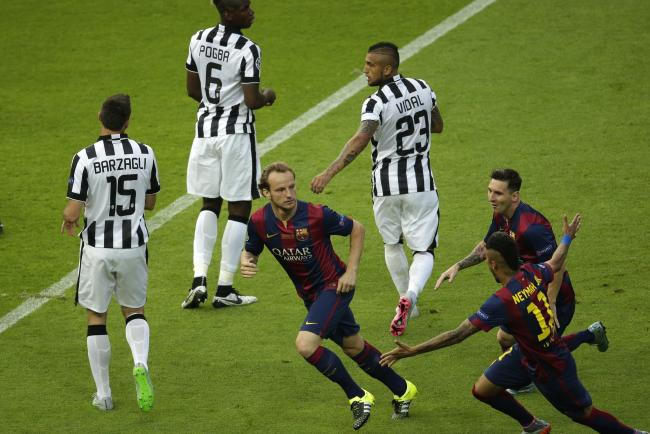 Barcelona's Ivan Rakitic, center, celebrates scoring the opening goal during the Champions League final. June 6, 2015. (AP Photo/Michael Sohn)