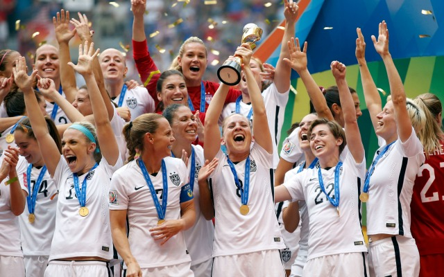 USWNT lifts the World Cup Trophy in Canada this past summer (USATSI)