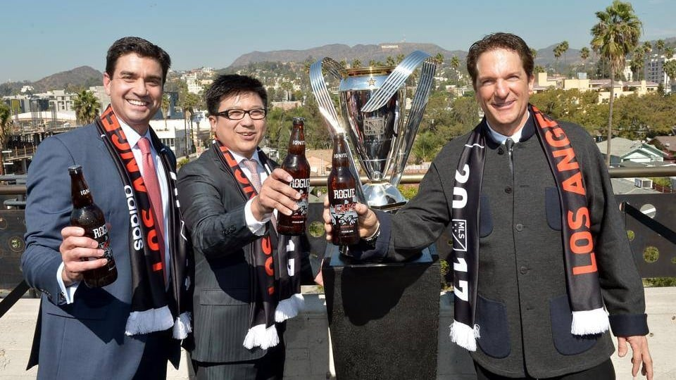 Henry Ngyuen, Tom Penn, and Peter Guber make up the majority LAFC ownership group.  Here they are drinking a Rogue special LAFC brew. Courtesy of the LAFC website