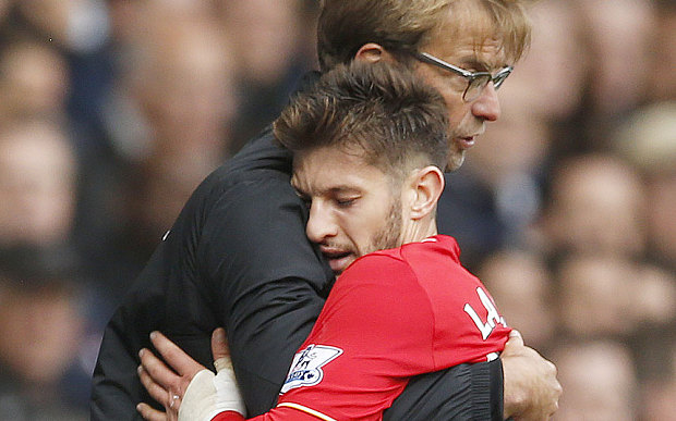 Photo - REUTERS Adam Lallana embraces Jurgen Klopp