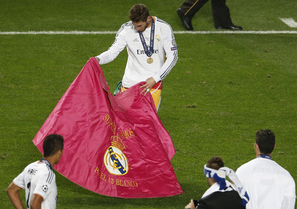 Ramos shows off his passes in Lisbon as Real Madrid win their 10th European Cup in 2014