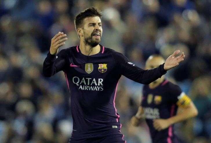 Pique scores two in a futile comeback against Celta Vigo.
