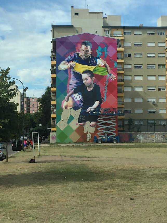 A mural which overlooks a dirt pitch outside La Bombonera dedicated to Carlos Tevez