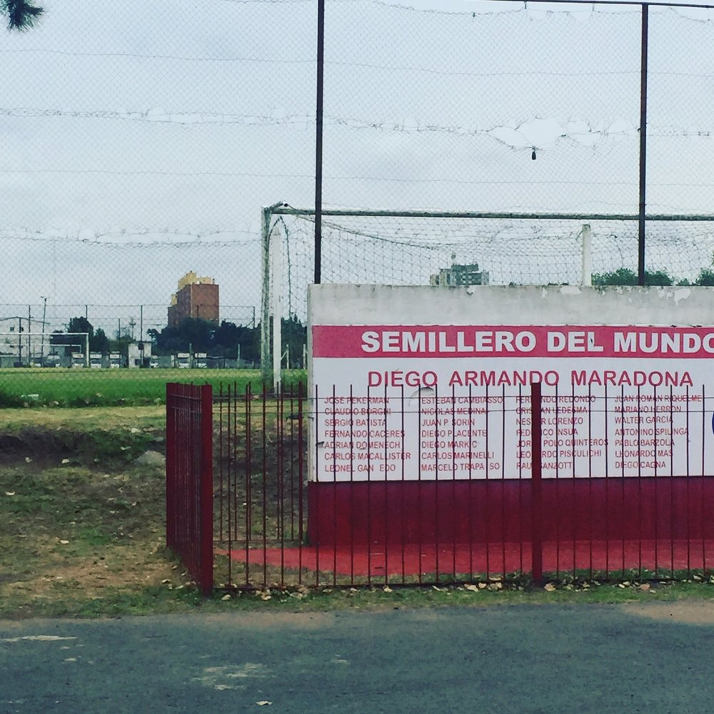 Perdio De Argentinos Juniors, Buenos Aires, Argentina - Kevin traces the routes of Diego Maradona in South America. Names such as Riquelme, Redondo, and Pekerman can be seen through the fence.