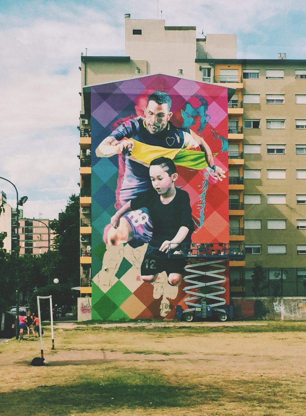 Buenos Aires, Argentina - Mural of Carlos Tevez doesn't lack any color looking down on a local field.